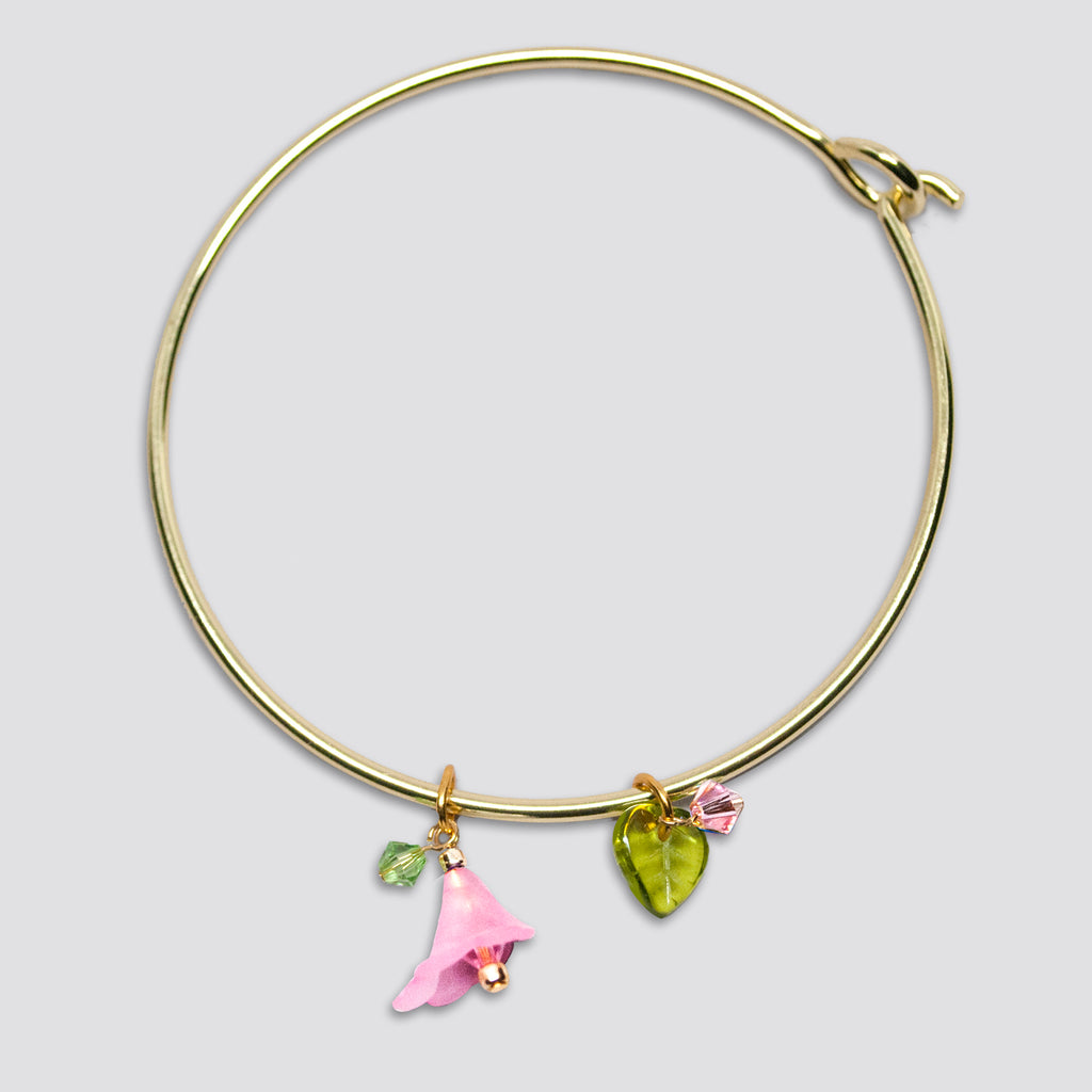 'Flower' (Pink) gold-tone bangle bracelet with Swarovski crystals