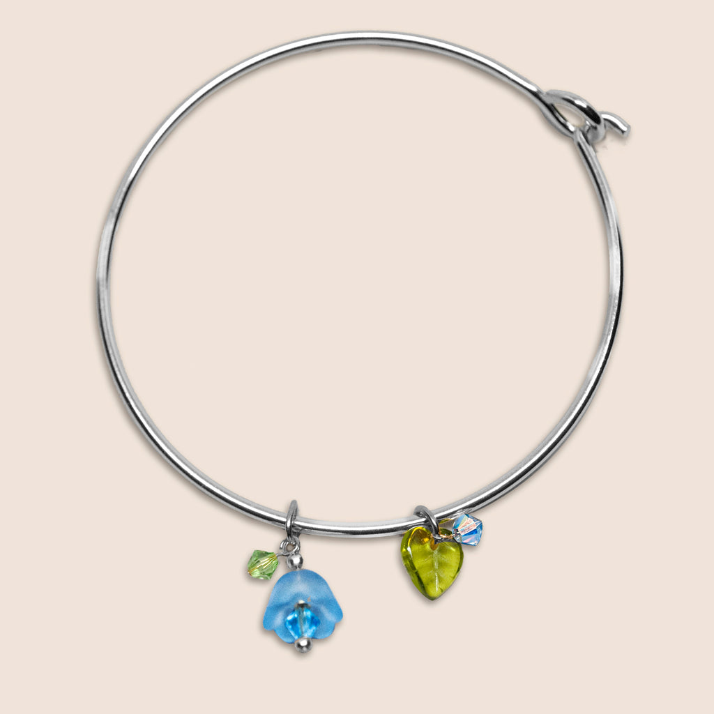 'Flower' (Blue) silver-tone bangle bracelet with Swarovski crystals