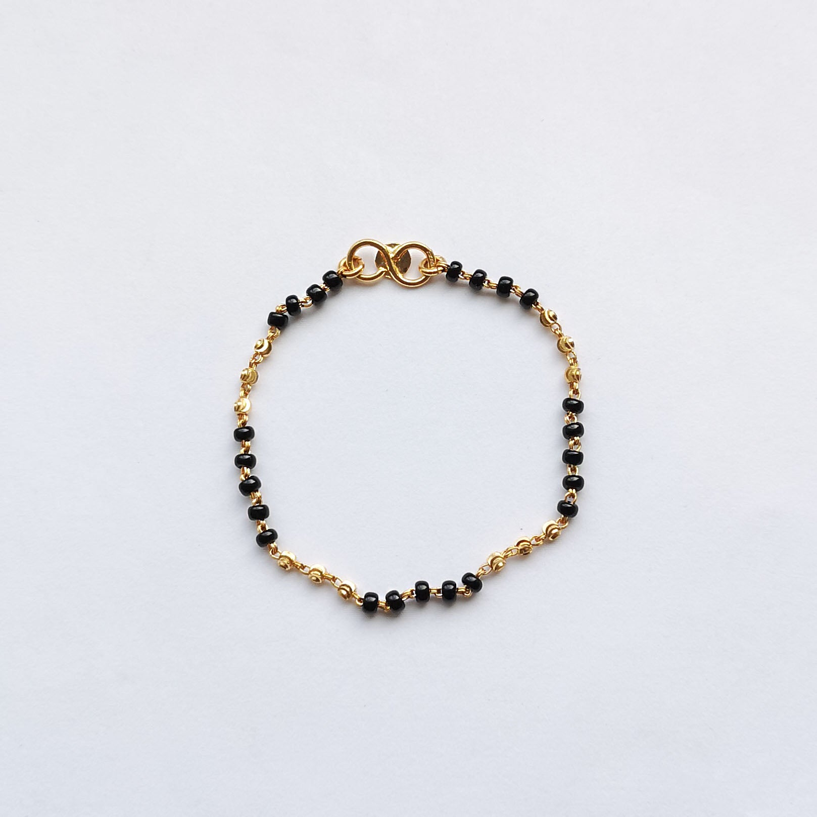 22ct Gold Children's Bracelets with Black Beads and Diamond Cut Design CBR-7908