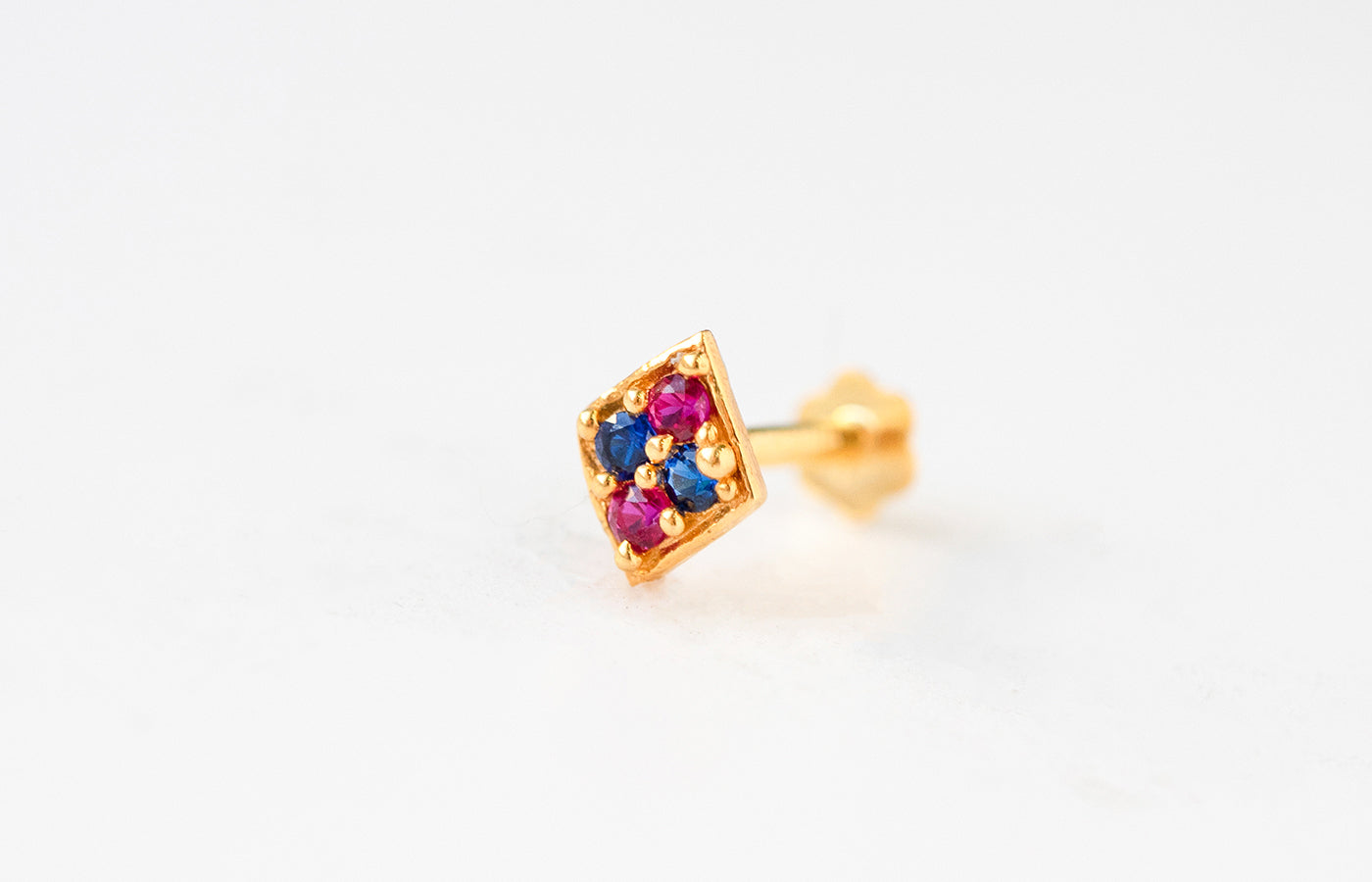 18ct Yellow Gold Screw Back Nose Stud set with two Red and two Blue Cubic Zirconias NIP-4-320d