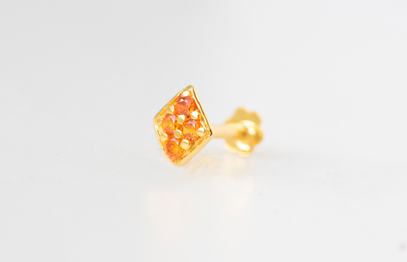 18ct Yellow Gold Screw Back Nose Stud set with four orange Cubic Zirconias NIP-5-570b