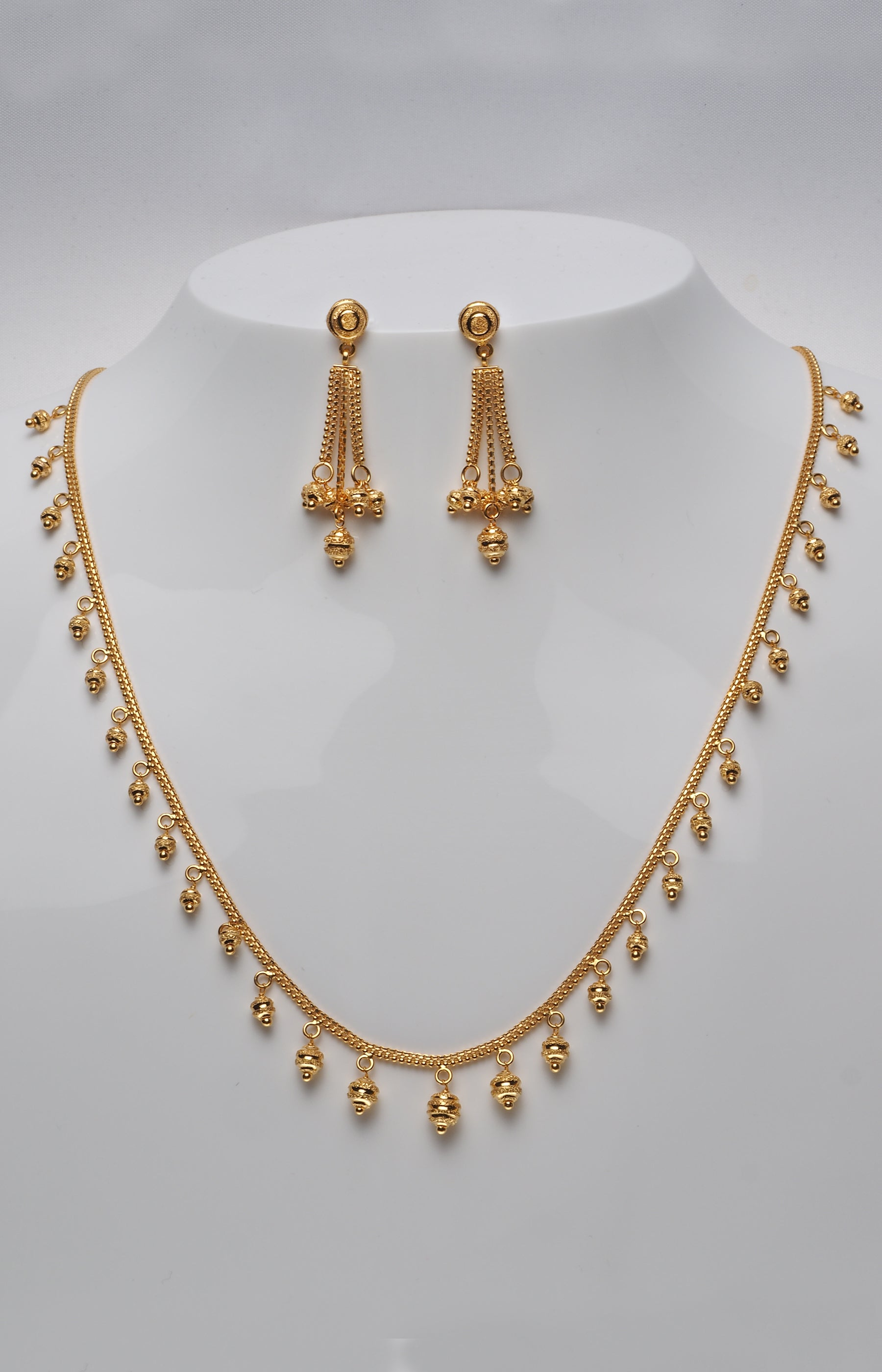 gold ragaa paisley necklace