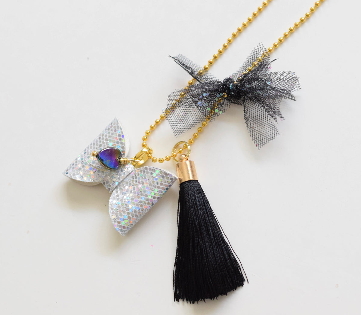 Galactic Bow Charm Necklace