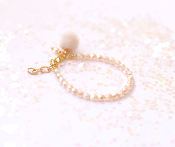 Ivory Cream Faceted Pom Pom Bracelet