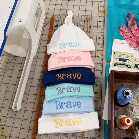 embroidered baby caps BRAVE