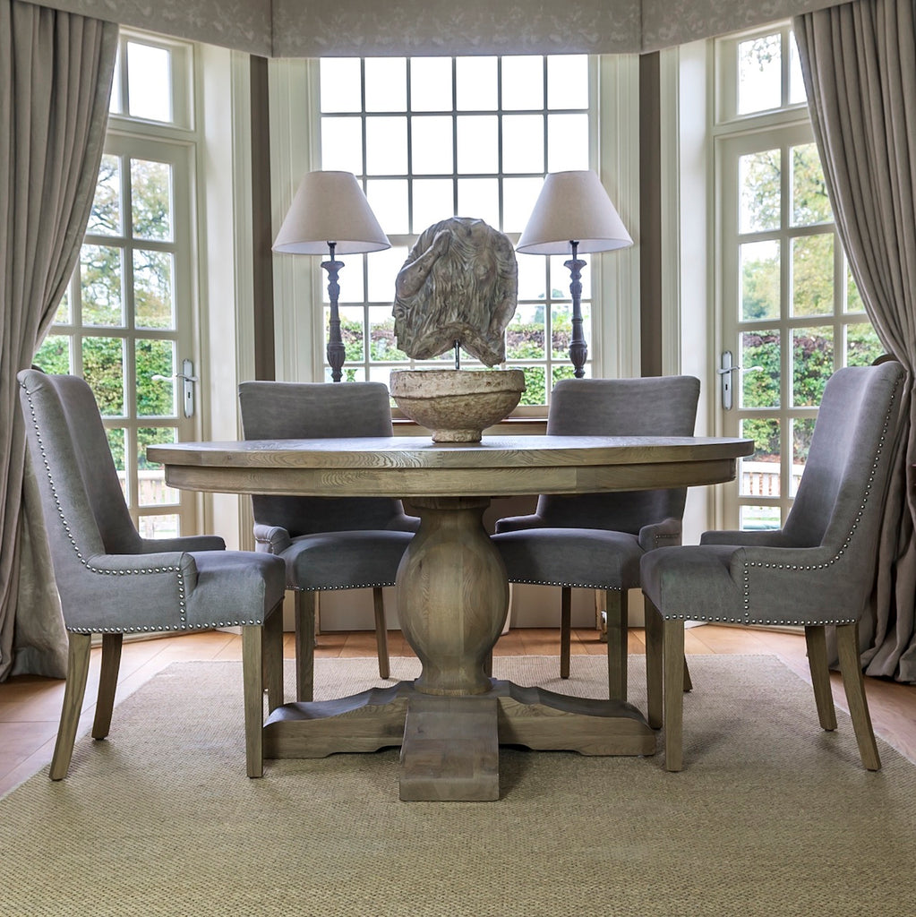 Amberley round dining table in bay window
