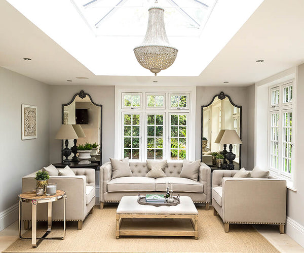 Symmetry in interiors with mirrors either side of window and positioning of Heavenly Sofa and Heavenly Armchairs