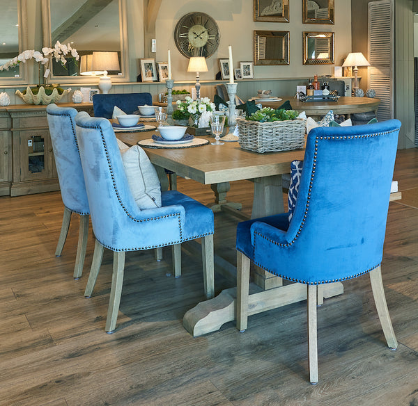 Belvedere weathered oak dining table and Hamilton velvet upholstered dining chairs in La Residence Interiors' showroom