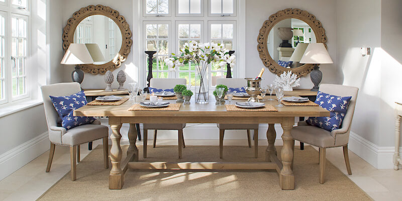 A pair of Marlborough weathered oak mirrors either side of a window create symmetry