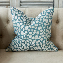 Pebble textured cushion in light teal colour with tonal piping