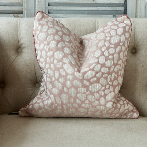 Pebble textured cushion in blush pink with tonal piping