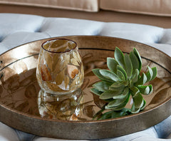 Small glass tealight holder with delicate leaf detail
