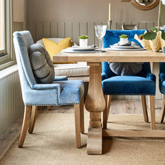 Pale blue and royal blue velvet Hamilton dining chairs at one end of Belvedere weathered oak dining table