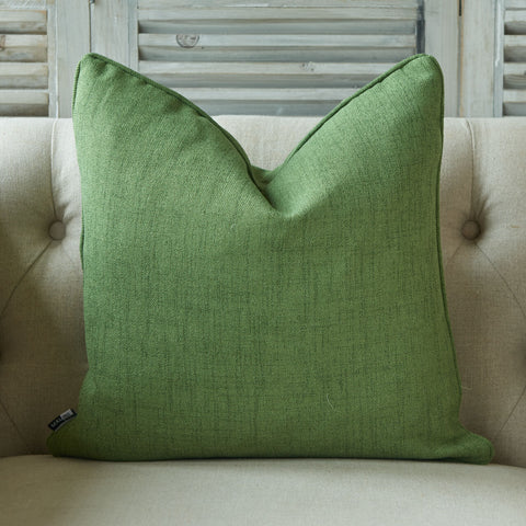Light green textured linen cushion with piped edge