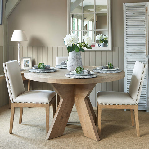 Newport round weathered oak dining table with contemporary crossed plank style base