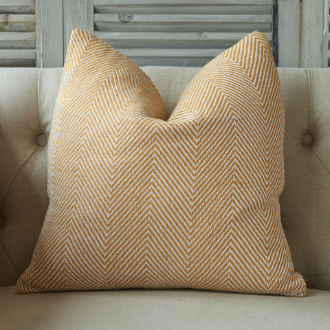 Recycled woven cushion with orange chevron design