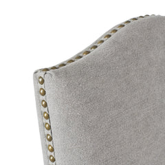 Portman dining chair in dove grey top of seat brass stud trim and scalloped top detail