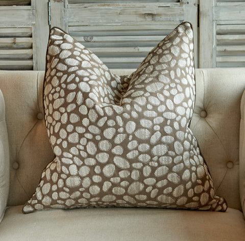 Taupe and oatmeal pebble cushion