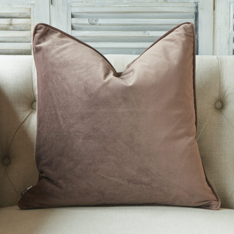 Soft matte luxury velvet cushion with piped edge in a truffle colour