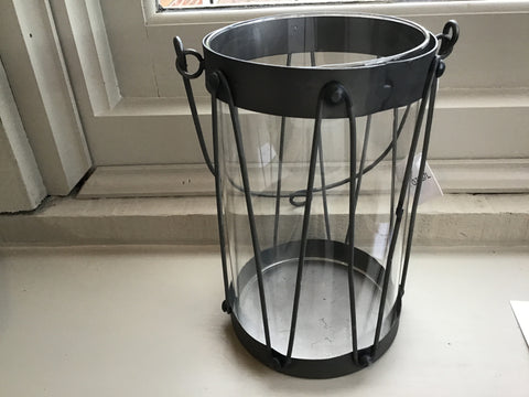 Wire lantern with metallic base and rim and wire handle