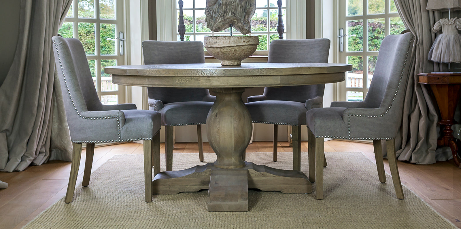 Amberley round dining table