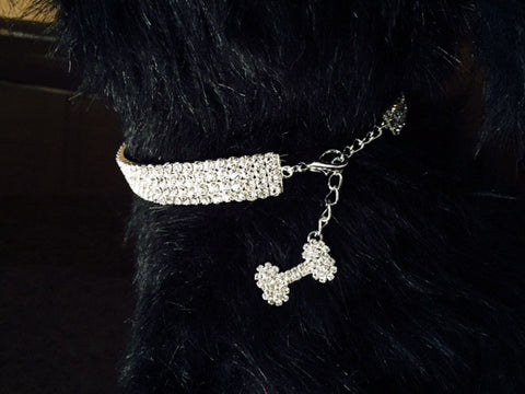 Necklace with 5 rows of Sparkling Crystals and a Beautiful Dangling White Crystal Bone