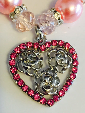Pink Pearl Necklace With a Dangling Crystal Rhinestone Heart