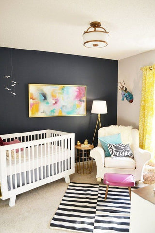 modern nursery with black accent wall