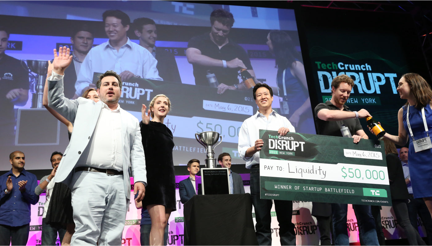 Victor W. Hwang and Elliott Gansner of Liquidity, accept the grand prize at the 2015 TechCrunch Disrupt Battlefield in New York City.