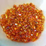 Orange Silverlined Rainbow 2-Cut 6/0 (637) Qty: 10 grams