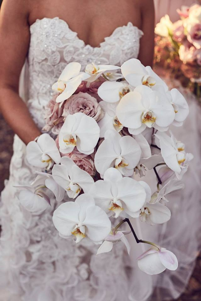 Bridal bouquet of white phalaenopsis orchids and pink roses