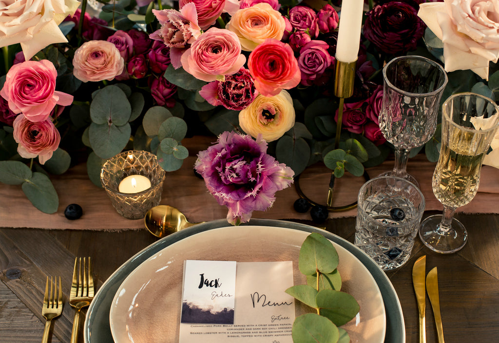 Wedding reception guest table florals