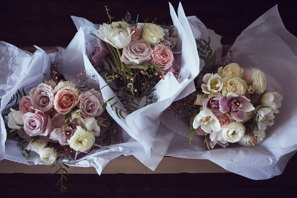 Bridesmaid bouquets in soft pink and white