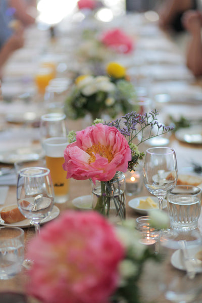 Mixed floral vases on reception tables
