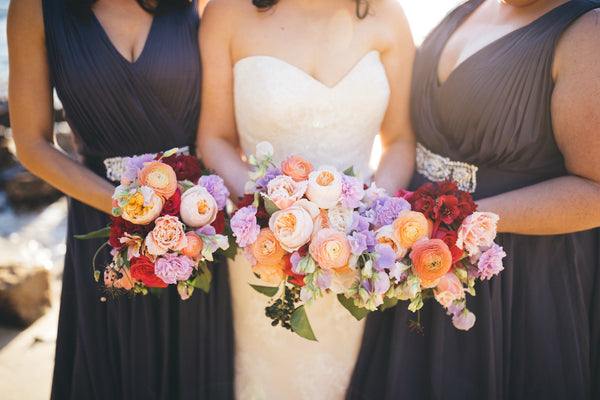 Bridal bouquets in peach, lavender and hot pink