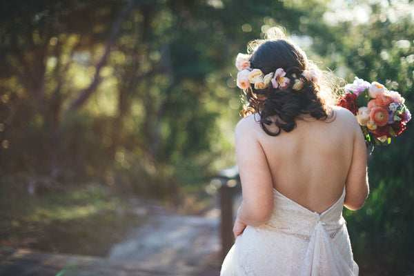 Bride in peach flower crown and pastel bouquet