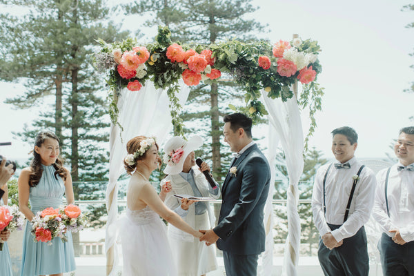 Wedding ceremony with floral arch