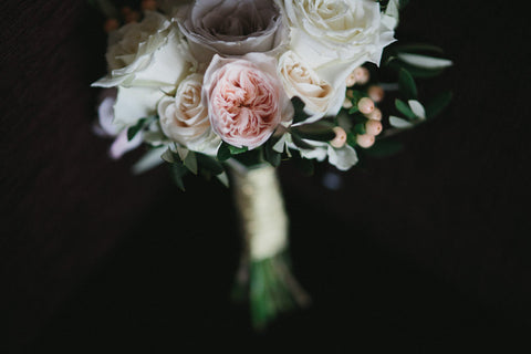 Bridal bouquet of whites and pastel with olive foliage