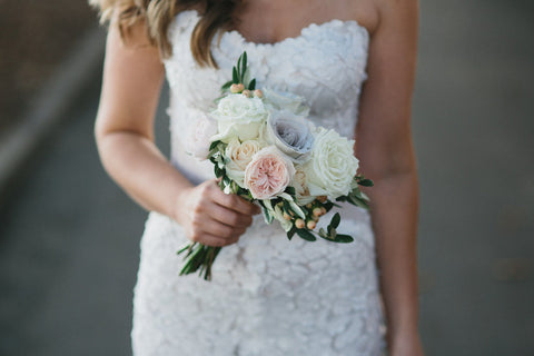 Soft white and pastel bridal bouquet.