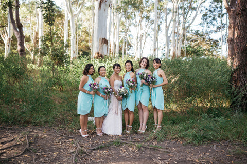 Bride and Bridesmaids pose for a photo