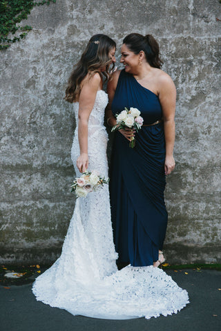 Bride and Bridesmaid with their bouquets.
