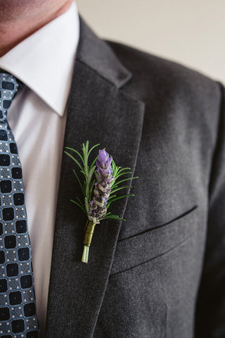 A close up image of Bryan's buttonhole of rosemary and lavender.