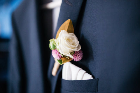 Close up of the Groom's rustic style buttonhole