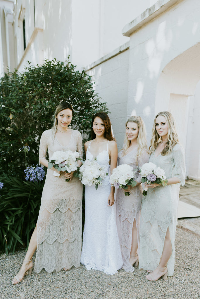 Bride and Bridesmaid with pastel bouquets