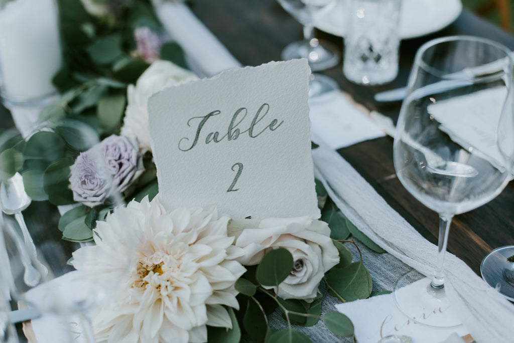 guest table florals with foliage and flower runner
