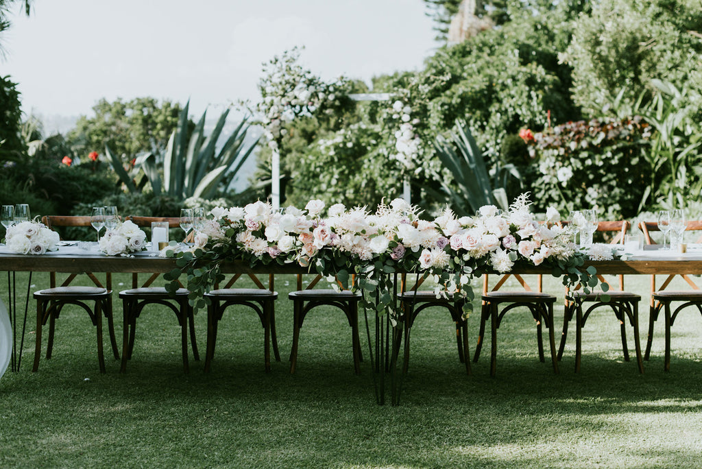 Bridal table with pastel floral runner
