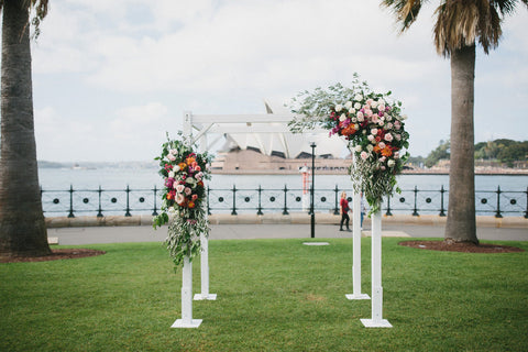 Wedding ceremony floral arbor on Sydney harbour overlooking the opera house.