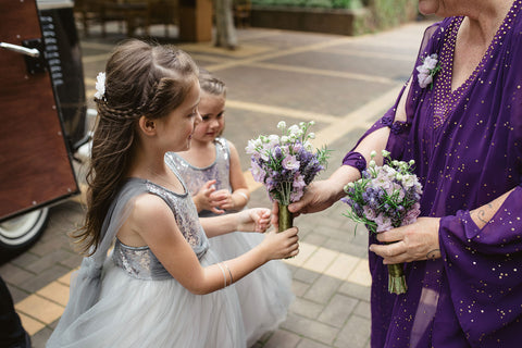 Flower girls receiving their bouquets.