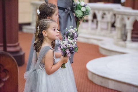 Flower girls with their bouquets in the Church.