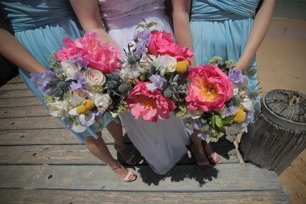 Bridal bouquets featuring coral peony